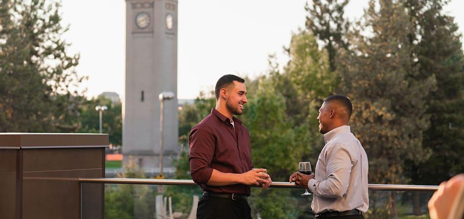 Drinks on Grand Terrace Bar | Two guys talking | Davenport Grand