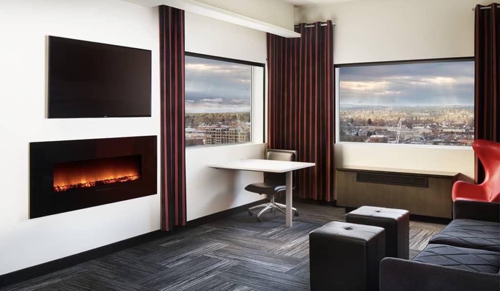 Davenport Grand | Penthouse Suite living area | Fireplace