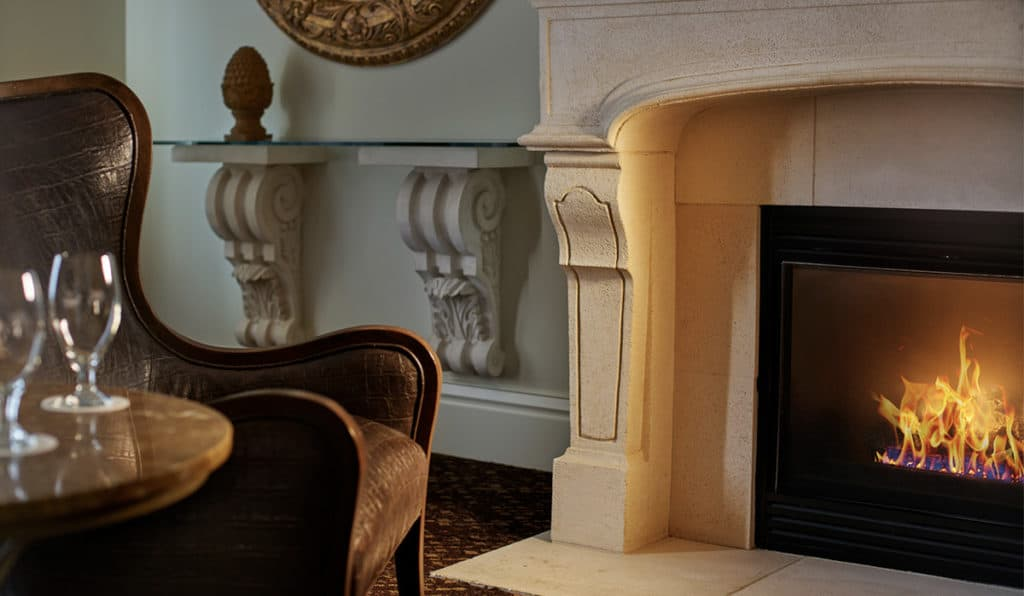 Davenport Lusso Suite Fireplace and chair