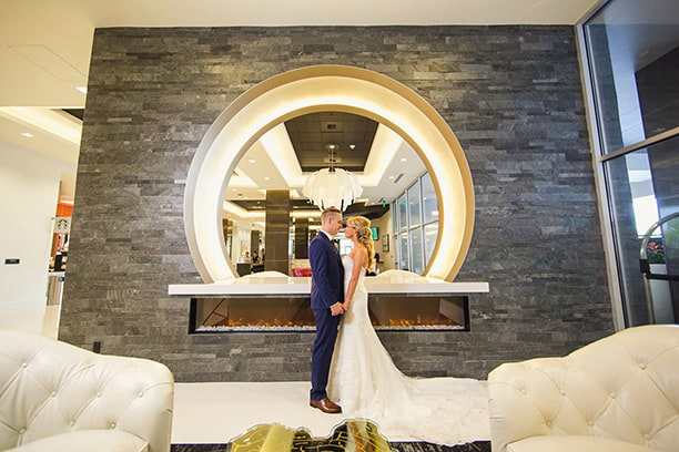Bride and Groom Kiss in Lobby