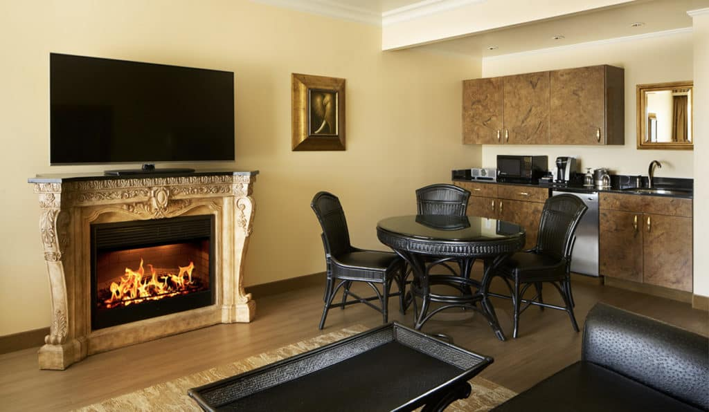 Davenport Tower Suite living area | Kitchen and table and fireplace