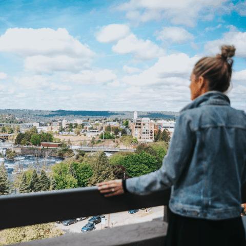 Women overlooking city | Davenport Centennial