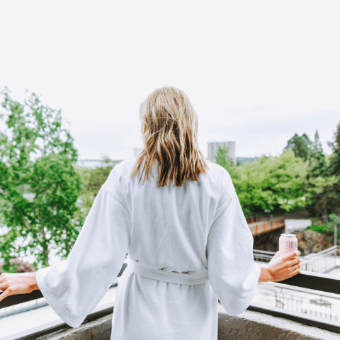 Women on balcony | Davenport Centennial
