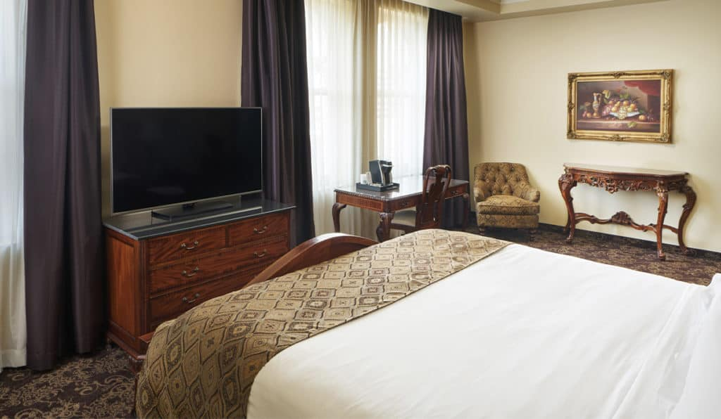 Superior Room- Queen bed, TV, desk, and chair | Historic Davenport