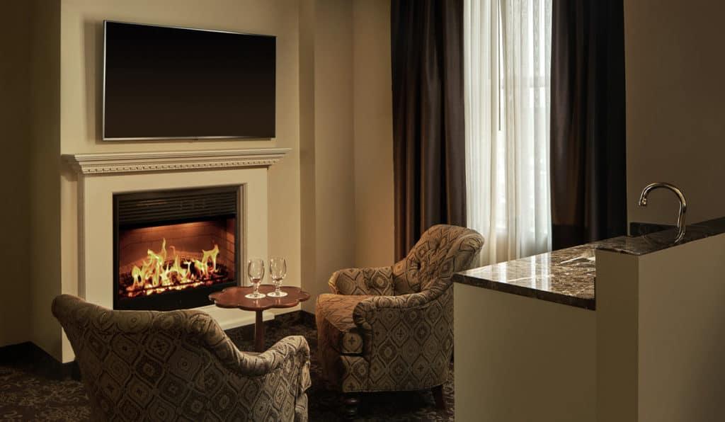 Honeymoon Suite living space - Fireplace | Historic Davenport
