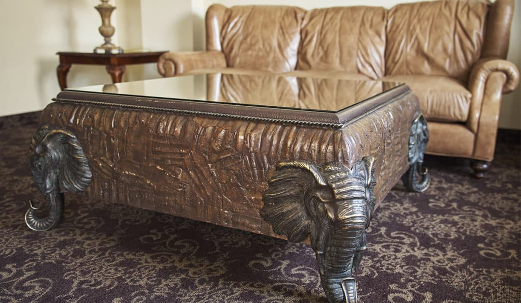 Table with elephant face legs | Apartments Room | Historic Davenport