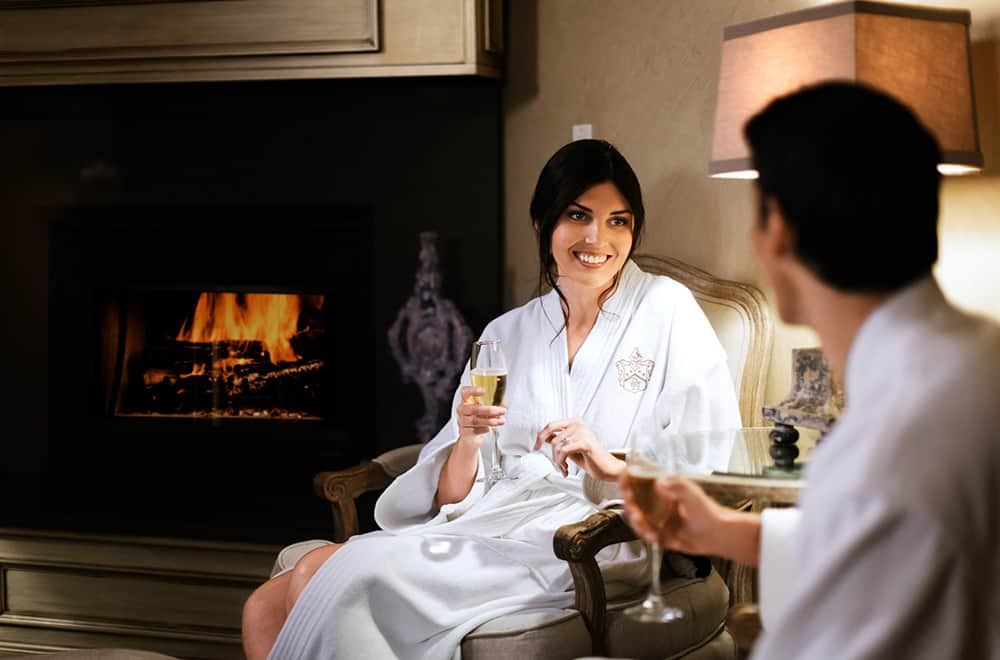 Spa | Woman by fireplace | Play | Historic Davenport