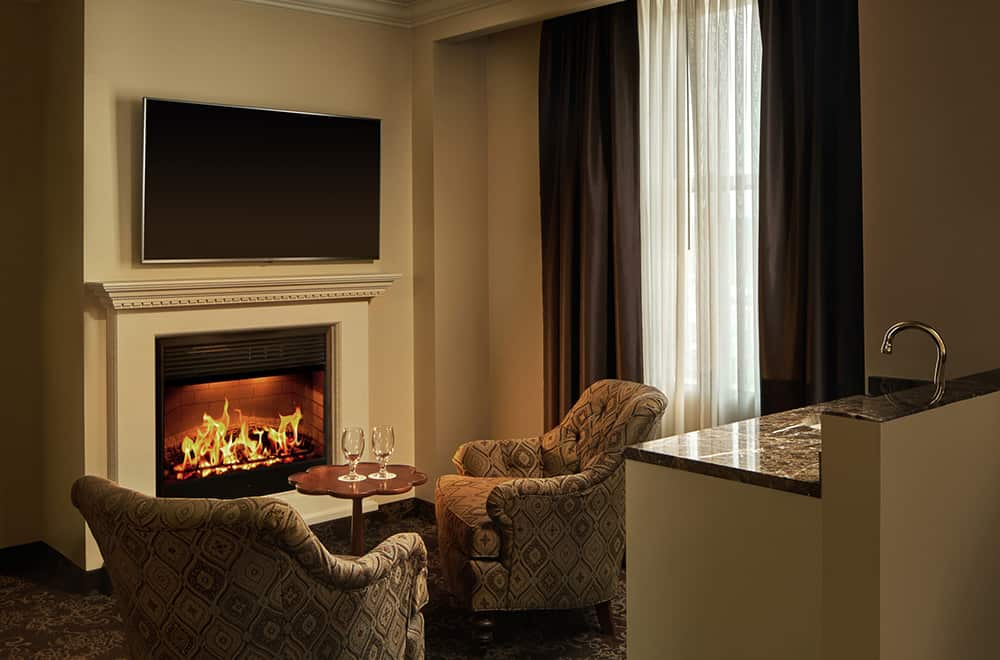 Fireplace with Chairs | Rooms | Historic Davenport