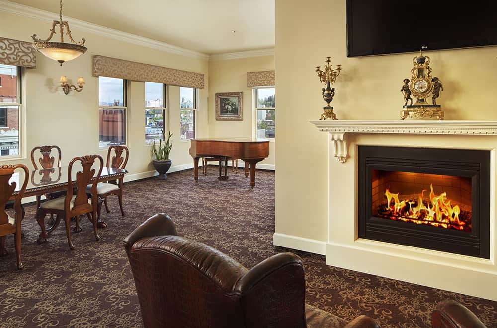 Fireplace and piano | Rooms | Historic Davenport