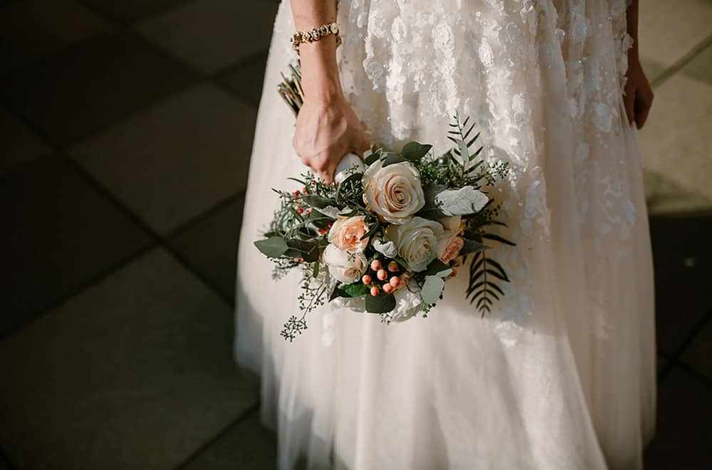 Bride with flowers | Weddings | Historic