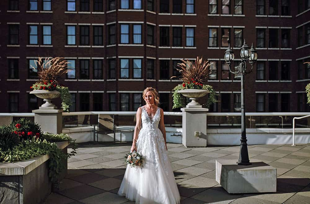 Bride on rooftop | Weddings | Historic