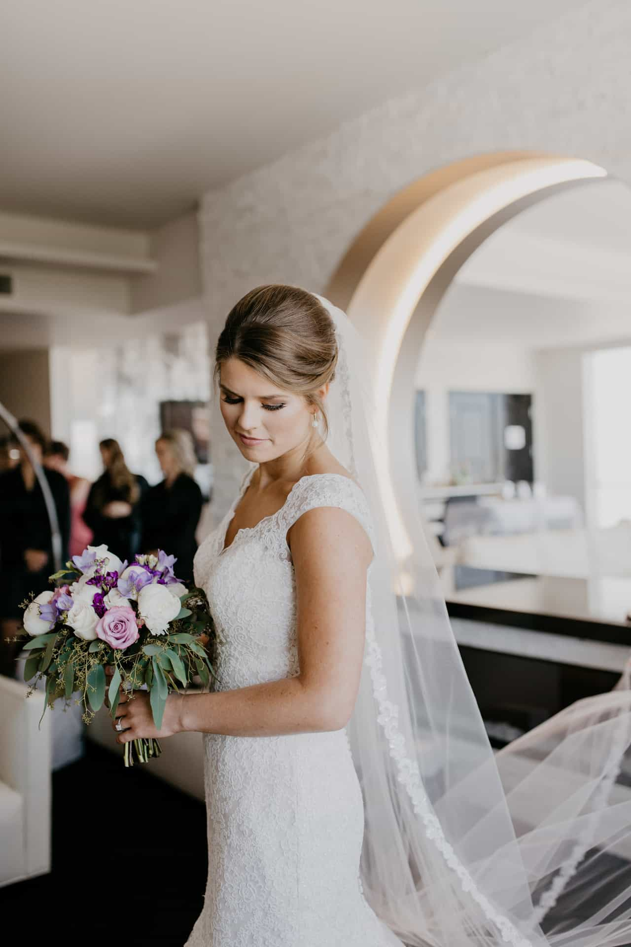 Bride holding flowers at Davenport Grand