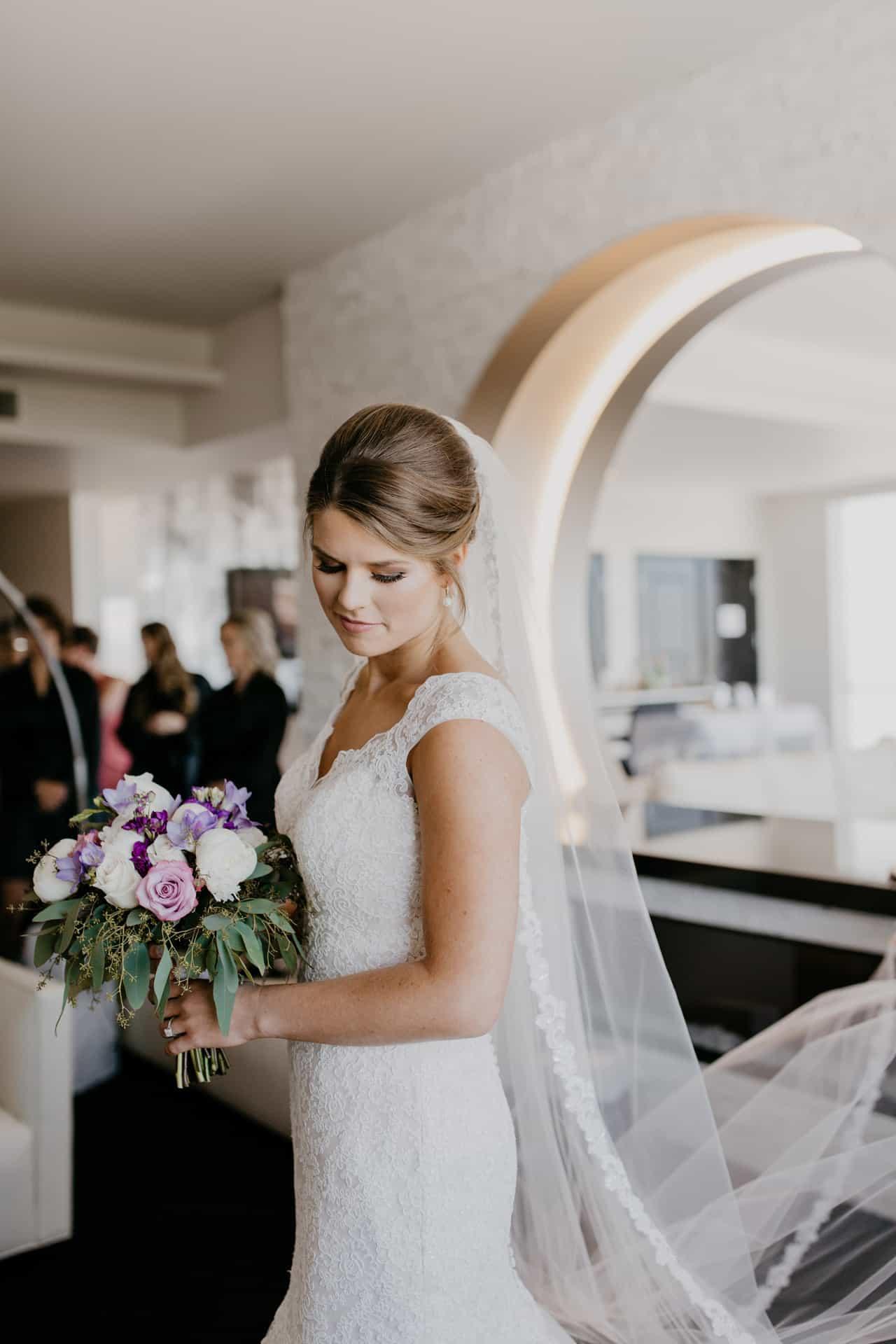 Bride holding flowers at Davenport Grand