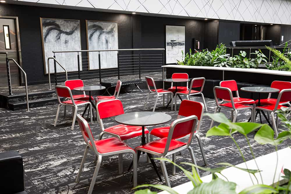 Centennial | Lobby with red chairs