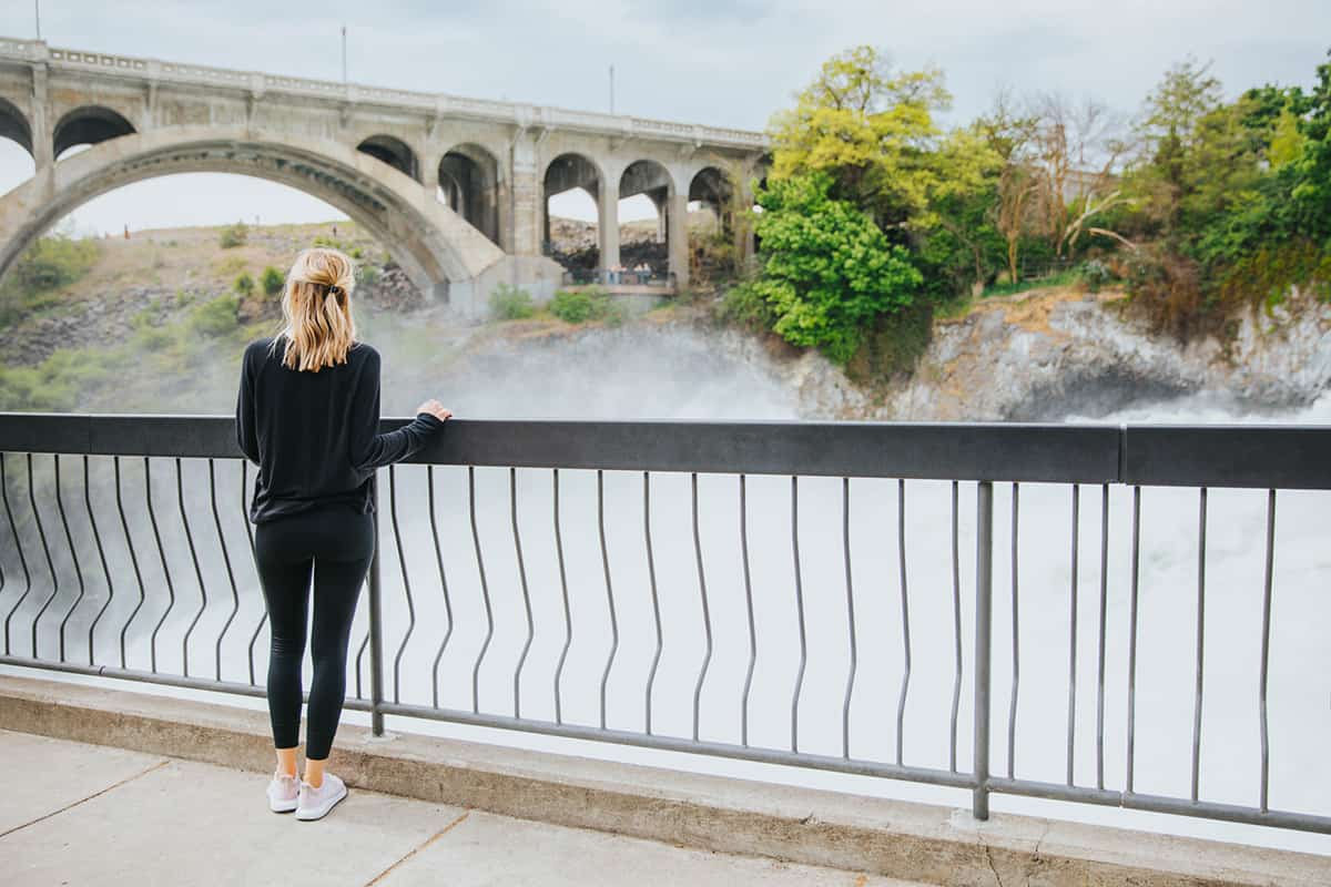 Women looking over rail by river | Davenport Grand