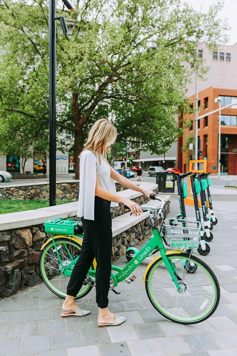 Women Getting on Bike in Town | Davenport Grand