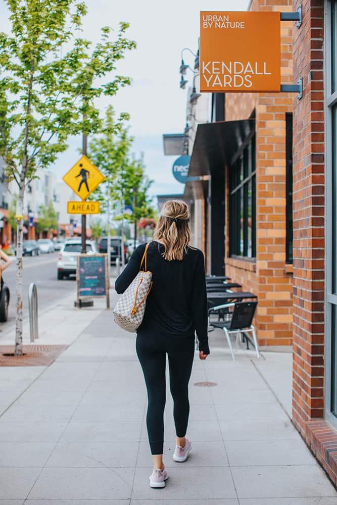 WOmen walking down street by shops | Davenport Centennial