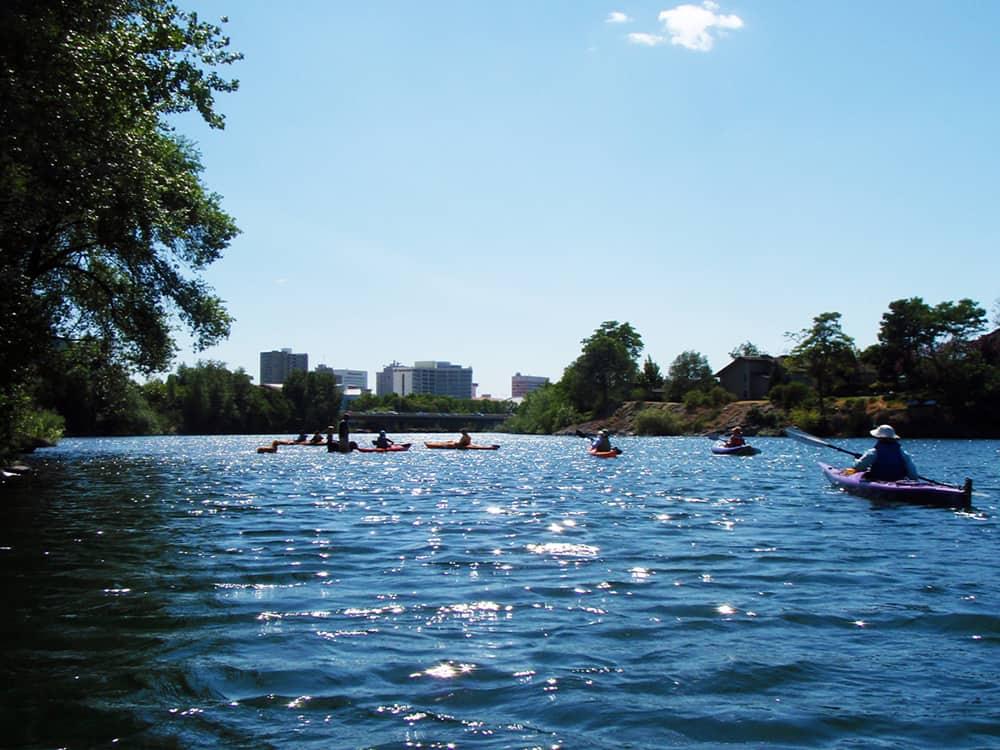 People kayaking down river | Davenport Centennial