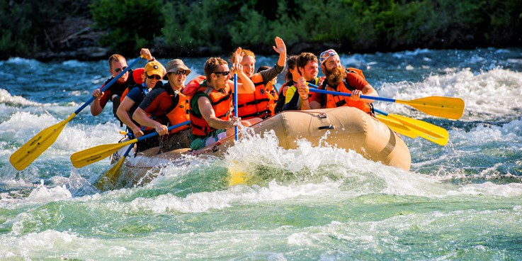 People white water rafting down river | Davenport Centennial