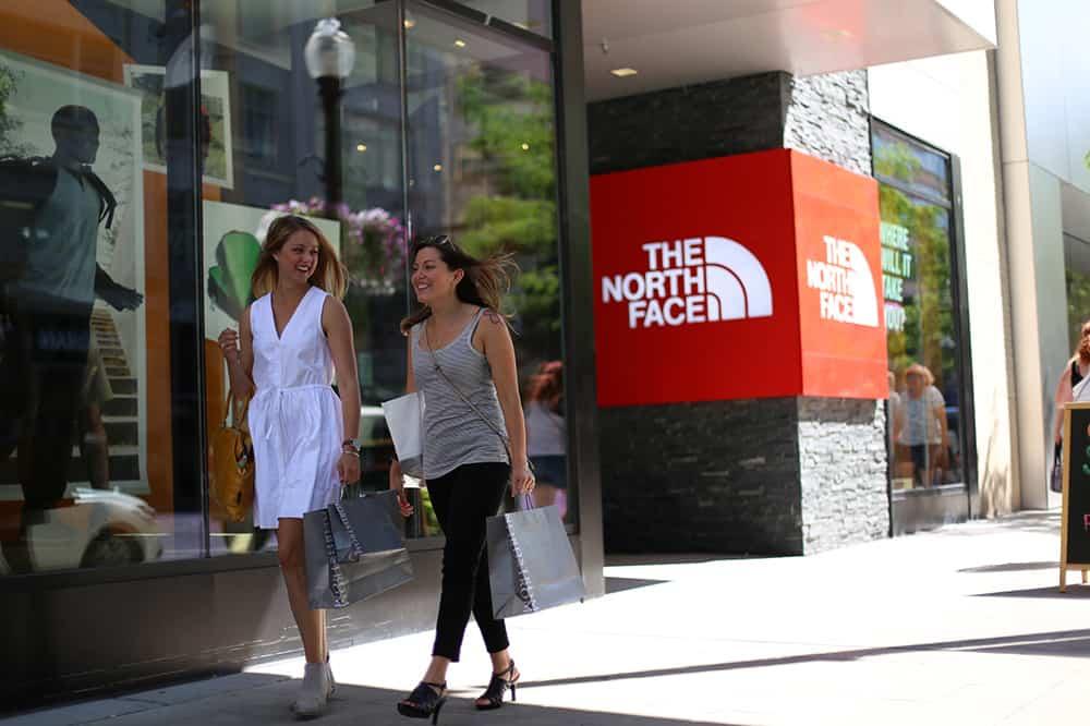 women walking by shops