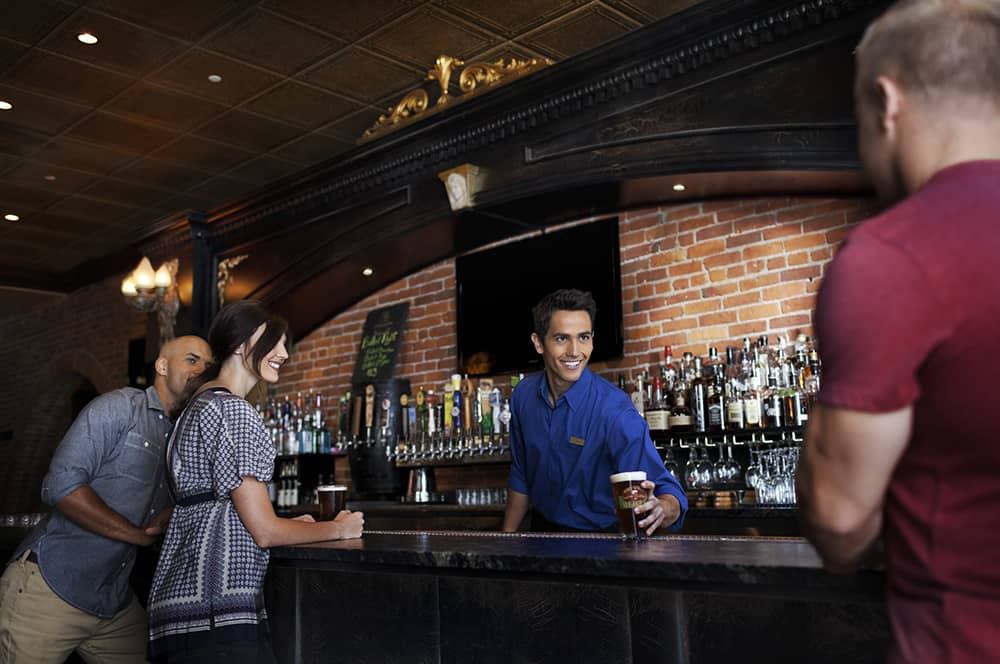 People at bar getting drinks | Davenport Lusso