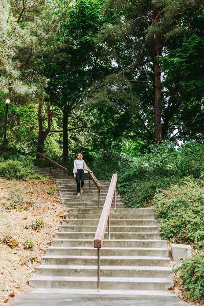 Women walking down stairs in park