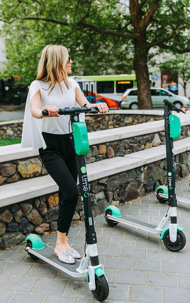 Women on a scooter outside
