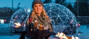 Women serving drinks outside in snow | Davenport Grand